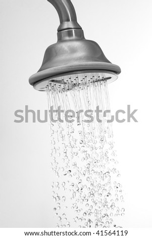 Water flowing in a old metal shower - swallow DOF.focus on top.some water drops are blurry due to water speed. - stock photo