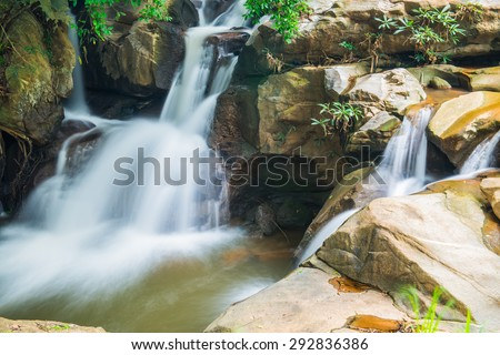 Water Flowing in Thai Forest, Thailand. - stock photo