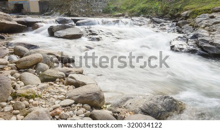 water flowing over falls at outdoor natural on hill