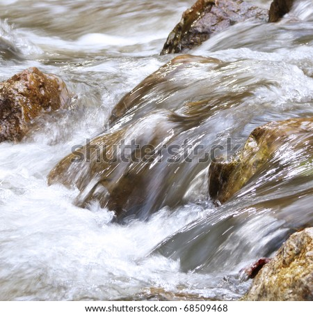Water flowing over stones - stock photo