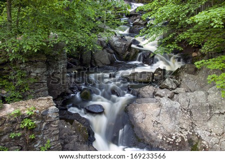 Water flowing through Southford falls in Spring, - stock photo
