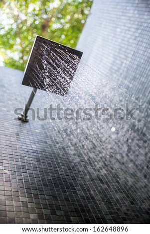 water from rain shower outdoor - stock photo
