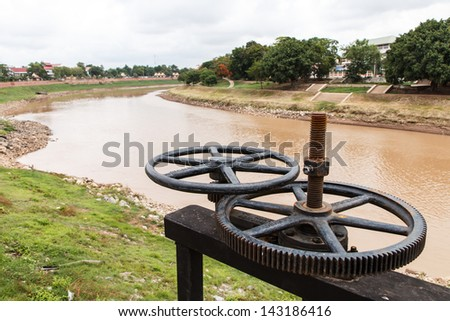 Water gate gear and Nan river view, Thailand - stock photo