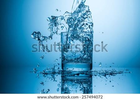 water glass splash - stock photo
