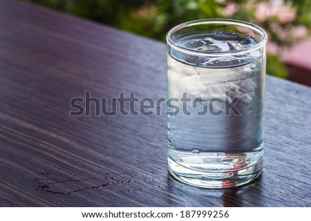 water glass with some ice - stock photo