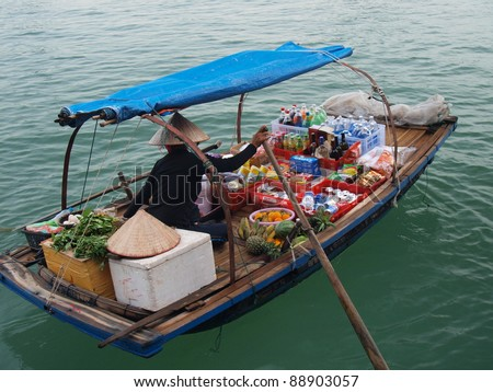 water hawker in Halong Bay, Vietnam