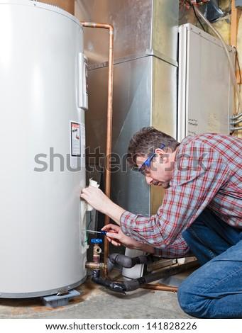 Water heater maintenance - stock photo