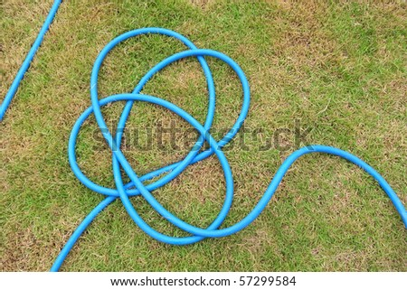water hoses lie on the garden (1) - stock photo