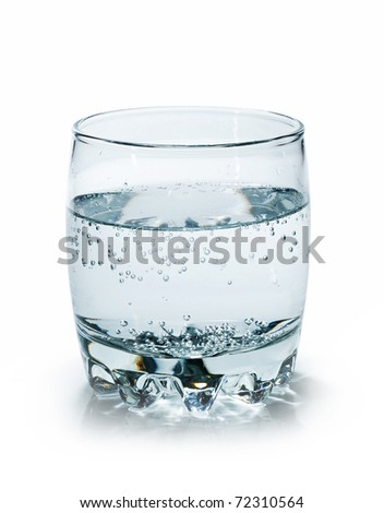 water in a clear glass beaker - stock photo
