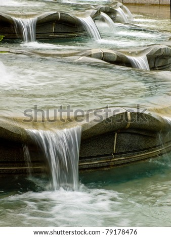Water in a Fountain Flowing with a Slow Shutter - stock photo
