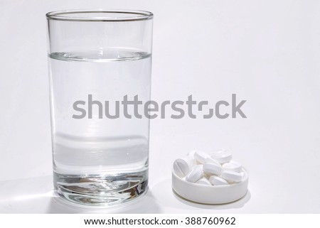 Water in glass and Drug isolate on white background - for take a medicine - stock photo