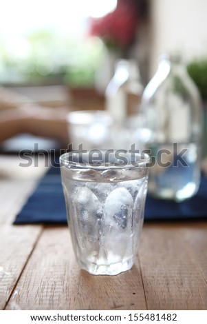 Water in glass in wood background - stock photo