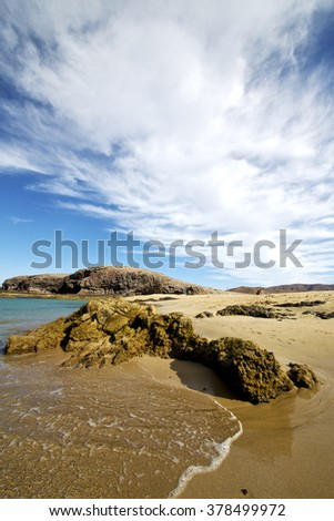 water in lanzarote coastline  froth  spain pond  rock stone sky cloud beach   musk  and summer     - stock photo