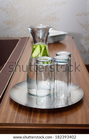 Water in pitcher on wood furniture serving for VIP  - stock photo