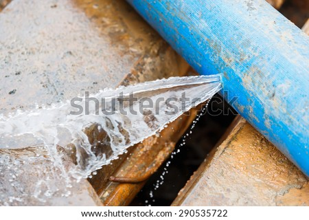 Water leaking on pvc discharge hose in construction site - stock photo