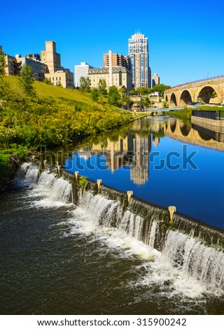 Water level control dam at Mill Ruins Park in downtown Minneapolis. - stock photo