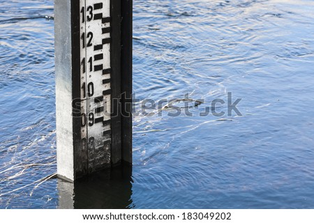 Water level measurement gauge used to monitor the water levels. Water level measurement during flood. - stock photo