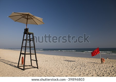 Water lifeguard stand with umbrella - stock photo