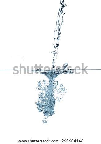 Water making bubbles upon being poured into more water, isolated on white background