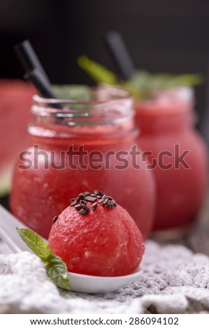 Water melon smoothie on wooden table