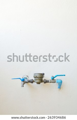 Water Meter and Valve with Pipe on white Wall - stock photo