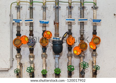 Water meters and pipes - stock photo