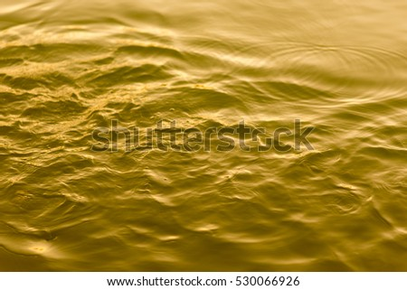 water of Still gold abstract background