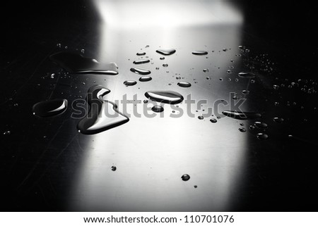 water on the black background - stock photo