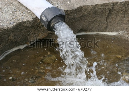 Water out of Pipe - stock photo