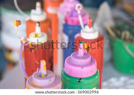 Water paint in plastic bottle for art and craft learning experience - stock photo