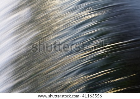 Water pattern tumbling over the spillway of the Fairmont Water Works on the Schuylkill River. - stock photo