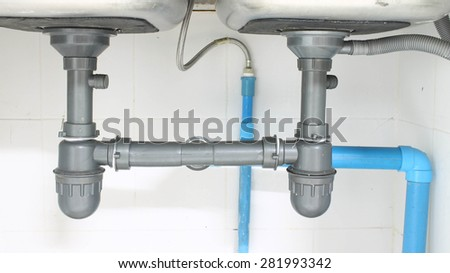 Water pipe  under sink on White background - stock photo