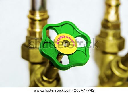 Water pipe valve close up. Creative energy saving concept. - stock photo