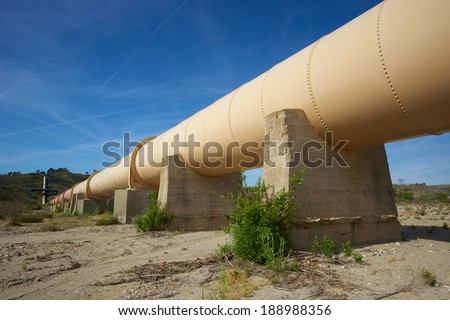 Water pipeline supplies the precious resource through the Los Angeles Aqueduct to the city. - stock photo