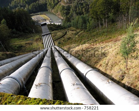 Water pipeline transporting water down to a valley accumulation station. - stock photo