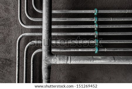 Water pipes arranged at right angles and two levels - stock photo