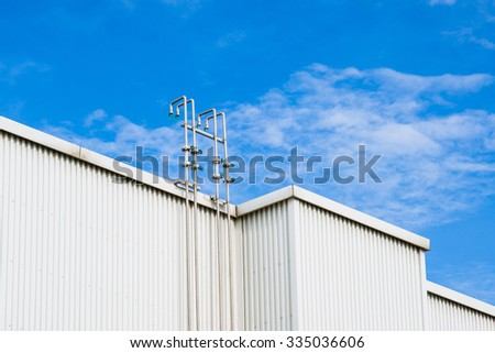Water pipes on the roof top of building - stock photo