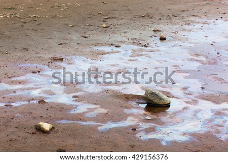 Water pollution gasoline. Stains on the water - stock photo