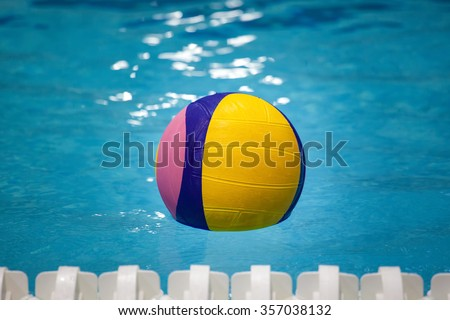 Water polo ball in a swimming pool - stock photo