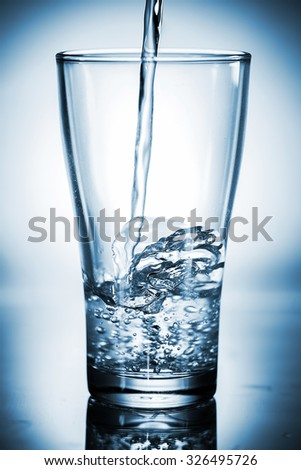 Water pouring in a glass