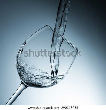 water pouring in a wine glass