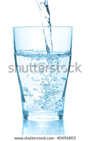Water pouring into glass. White background - stock photo