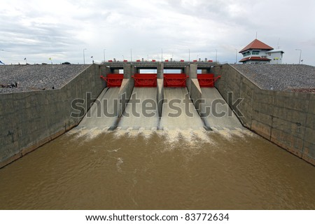 Water pouring through the water gates at dam - stock photo