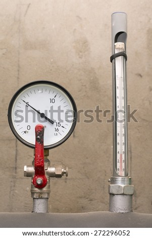 Water pressure sensor and a thermometer - stock photo