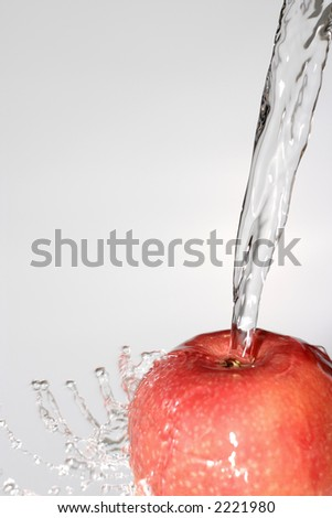 water puring on an apple - stock photo