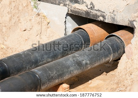 Water PVC Plastic Pipes in Ground during Plumbing Construction - stock photo