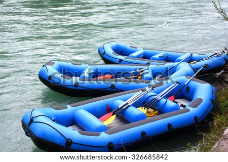 Water rafting with rafting boats - stock photo
