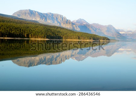 Water reflections in Glacier National Park. - stock photo