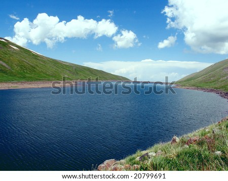 water reservoir in mountains - stock photo