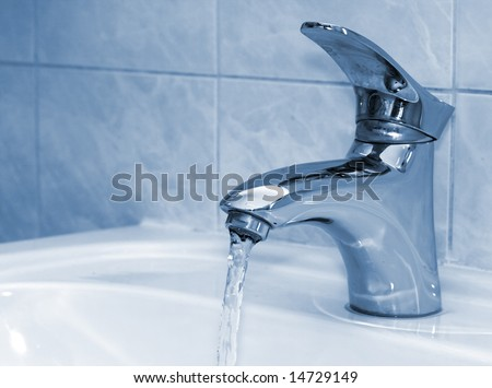 Water running from an open water faucet